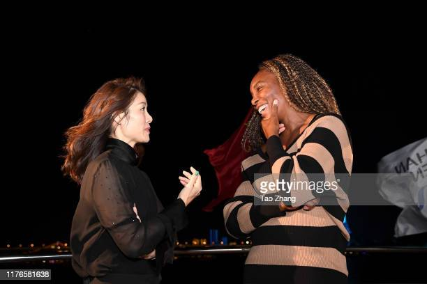Venus Williams of USA and Li Na of China chat while posing for photos on the Yangzi river on Day 2 of 2019 Dongfeng Motor Wuhan Open at Optics Valley...