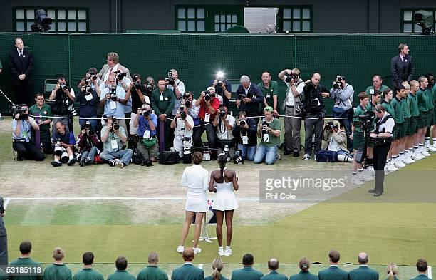 Venus Williams of USA and Lindsay Davenport of USA hold the trophies as they pose for photos after Williams won in three sets during the Ladies Final...