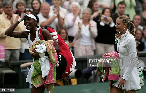 Venus Williams of USA and Maria Sharapova of Russia walk off after Williams won in straight sets during the tenth day of the Wimbledon Lawn Tennis...