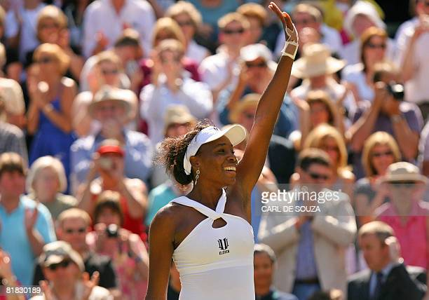 Venus Williams of USA celebrates after beating her sister Serena 7-5, 6-4, in the Women's Singles Final, during the 2008 Wimbledon Championships at...
