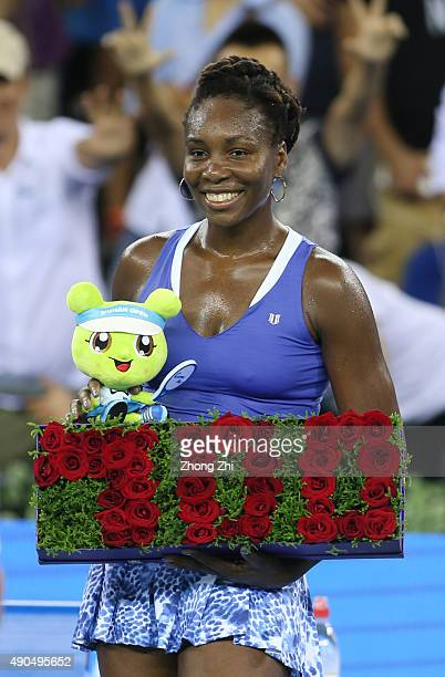 Venus Williams of USA celebrates the 700 winning in her career after winning the match against Julia Goerges of Germany on Day 3 of 2015 Dongfeng...