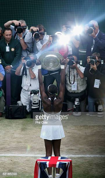 Venus Williams of USA holds the trophy as she poses for photos after Williams won in three sets against Lindsay Davenport of USA during the Ladies...
