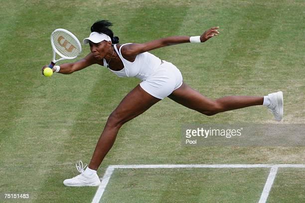 Venus Williams of USA plays a forehand during the Women's Singles semi-final match against Ana Ivanovic of Serbia during day eleven of the Wimbledon...