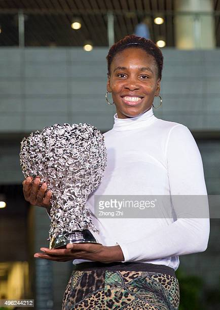 Venus Williams of USA poses with her trophy outside the stadium after winning the final match against Karolina Pliskova of Czech Republic on day 7 of...