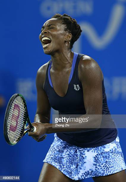 Venus Williams of USA reacts during the match against Carla Suarez Navarro of Spain on Day 4 of 2015 Dongfeng Motor Wuhan Open at Optics Valley...