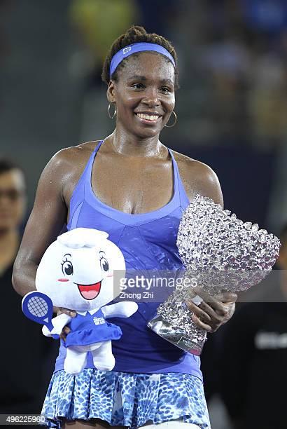 Venus Williams of USA reacts with trophy after winning the final match against Karolina Pliskova of Czech Republic on day 7 of Huajin Securities WTA...