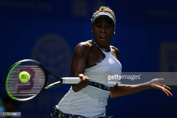 Venus Williams of USA returns a shot during the match against Danielle Collins of USA on Day 1 of 2019 Dongfeng Motor Wuhan Open at Optics Valley...