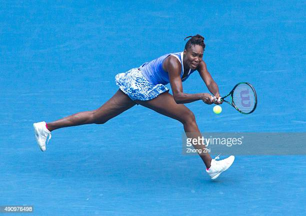 Venus Williams of USA returns a shot during the semifinal match against Roberta Vinci of Italy on Day 6 of 2015 Dongfeng Motor Wuhan Open at Optics...