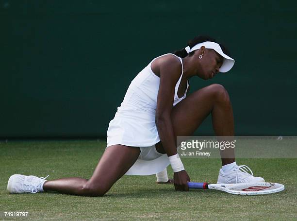 Venus Williams of USA slips during the Women's Singles first round match against Alla Kudryavtseva of Russia during day two of the Wimbledon Lawn...