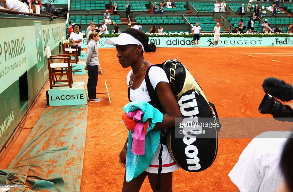 Venus Williams of USA walks off court after losing her women's singles second round match against Agnieszka Radwanska of Poland during day four of the French Open at Roland Garros on May 30, 2012 in Paris, France.