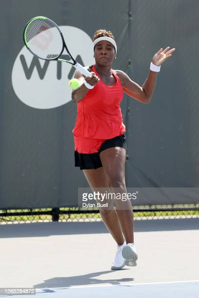 Venus Williams plays a forehand during her match against Victoria Azarenka of Belarus during Top Seed Open Day 2 at the Top Seed Tennis Club on...