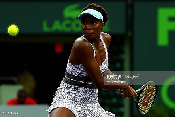 Venus Williams plays a match against Elena Vesnina of Russia during Day 5 of the Miami Open presented by Itau at Crandon Park Tennis Center on March...