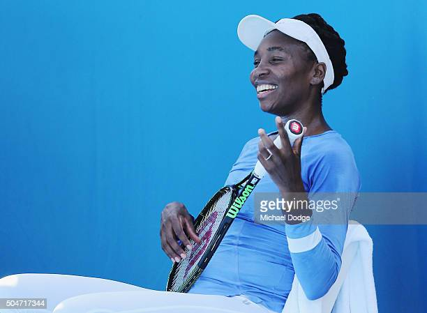 Venus Williams plays guitar on her racquet during a practice session ahead of the 2016 Australian Open at Melbourne Park on January 13 2016 in...