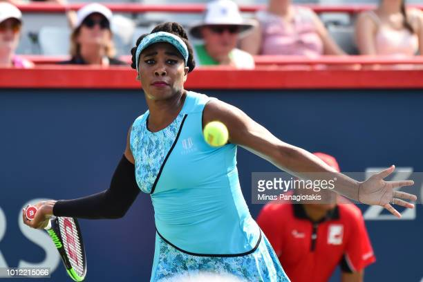 Venus Williams prepares to hit a return against Caroline Dolehide during day one of the Rogers Cup at IGA Stadium on August 6 2018 in Montreal Quebec...