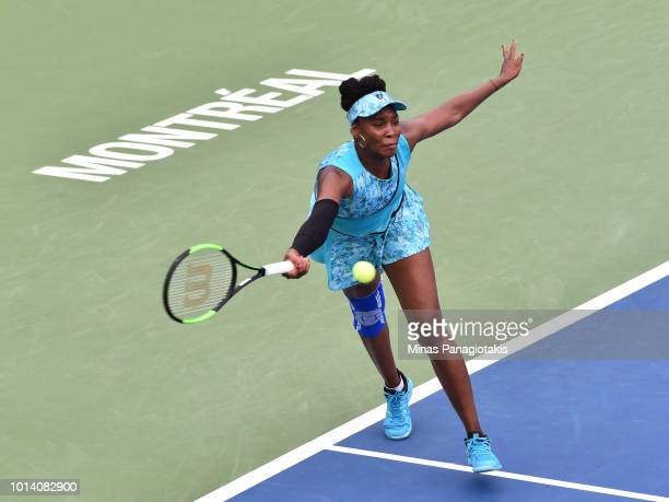 Venus Williams prepares to hit a return against Sorana Cirstea of Romania during day four of the Rogers Cup at IGA Stadium on August 9 2018 in...
