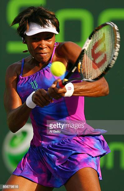 Venus Williams reacts returns a shot against Shahar Peer of Israel during day six of the Sony Ericsson Open at the Crandon Park Tennis Center on...