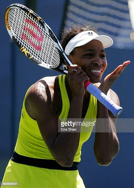 Venus Williams reacts to a missed point while playing Marion Bartoli of France during the final match of the Bank of the West Classic August 2, 2009...