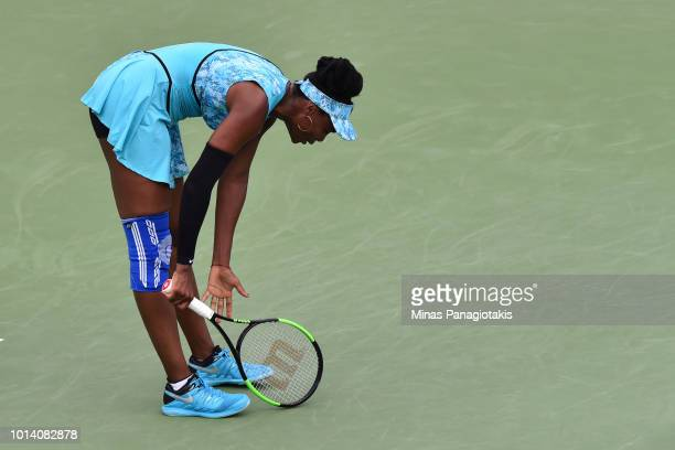 Venus Williams reads after losing a point against Sorana Cirstea of Romania during day four of the Rogers Cup at IGA Stadium on August 9 2018 in...