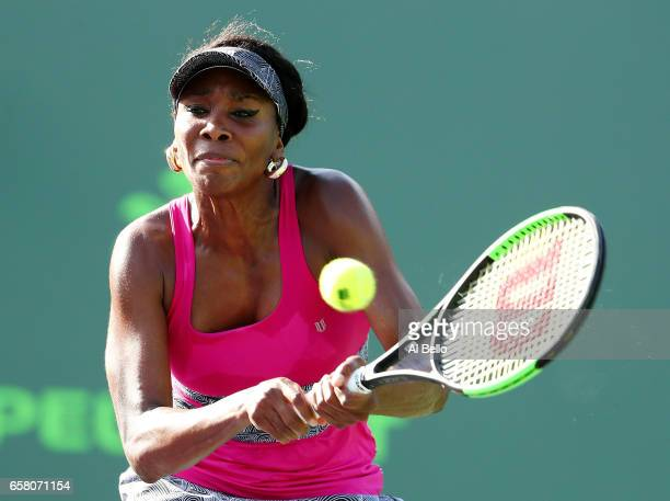 Venus Williams returns a shot against Patricia Maria Tig of Romania during Day 7 of the Miami Open at Crandon Park Tennis Center on March 26 2017 in...