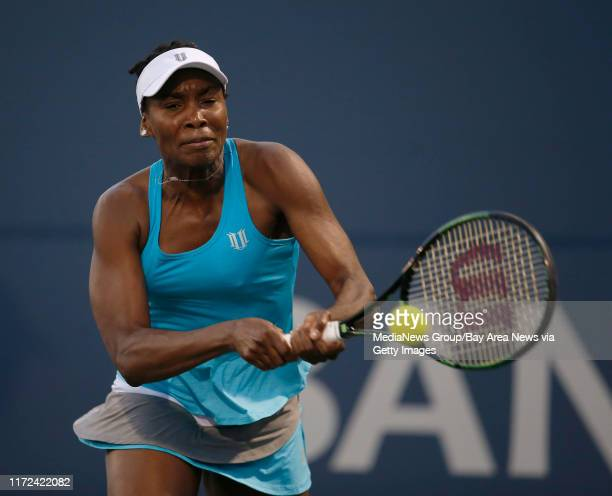 Venus Williams returns a shot by Alison Riske in the second set during the semifinals of the Bank of the West Classic women's tennis tournament at...