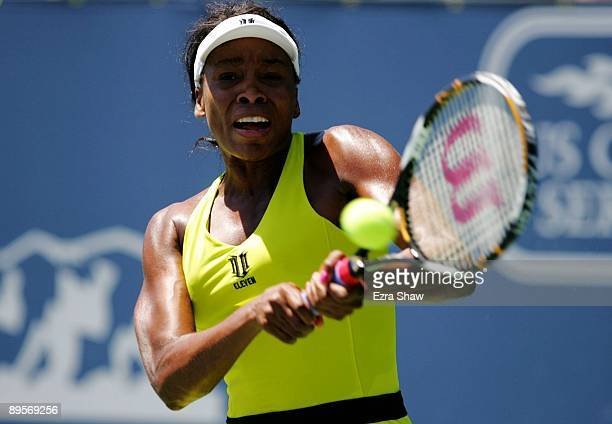 Venus Williams returns a shot to Marion Bartoli of France during the second set of the final match at the Bank of the West Classic August 2, 2009 in...