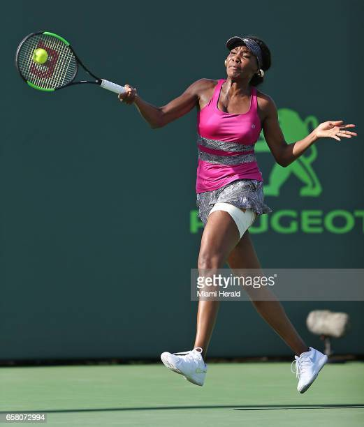 Venus Williams returns a shot to Patricia Maria Tig during a match at the Miami Open on Sunday March 26 2017 at the Crandon Park Tennis Center on Key...