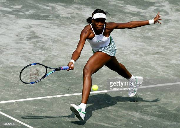 Venus Williams returns a shot to Vera Zvonareva of Russia during the Family Circle Cup April 16 at the Family Circle Cup Tennis Center in Charleston...
