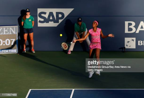 Venus Williams returns the ball against Magda Linette in the first set during the Bank of the West Classic tennis tournament at the Taube Family...