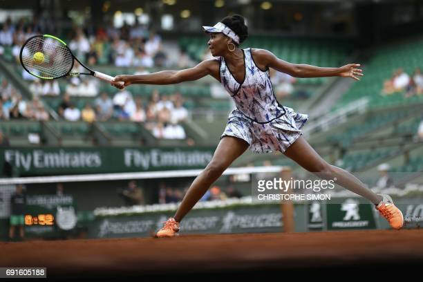 Venus Williams returns the ball to Belgium's Elise Mertens during their tennis match at the Roland Garros 2017 French Open on June 2 2017 in Paris /...