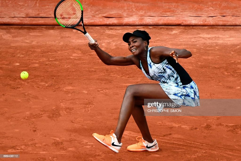 US Venus Williams returns the ball to China's Wang Qiang during their tennis match at the Roland Garros 2017 French Open on May 28, 2017 in Paris. /