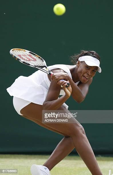 Venus Williams returns the ball to her Russian opponent Alisa Kleybanova during their 2008 Wimbledon championships tennis match at The All England...