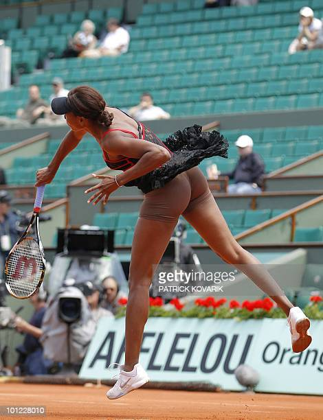 US Venus Williams reveals her skin toned underwear as she serves during her women's second round match against Slovakia's Dominika Cibulkova in the...