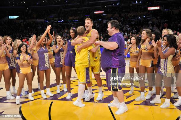 Venus Williams, Rob Gronkowski, James Corden and Ian Karmel celebrate after performing a dance routine with the Laker Girls during halftime at a...