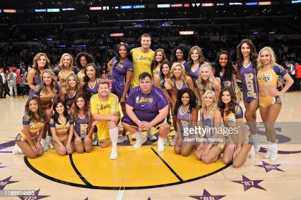 Venus Williams, Rob Gronkowski, James Corden and Ian Karmel pose for a photo with the Laker Girls after performing during halftime at a basketball...