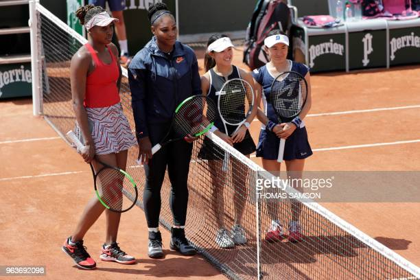 Venus Williams Serena Williams of the US Japan's Miyu Kato and Shuko Aoyama stand prior to the start of their women's doubles first round match on...