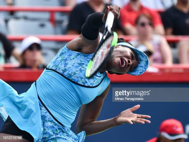 Venus Williams serves against Caroline Dolehide during day one of the Rogers Cup at IGA Stadium on August 6 2018 in Montreal Quebec Canada