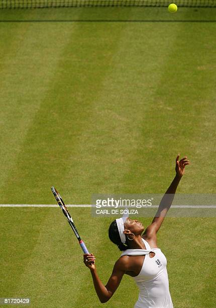 Venus Williams serves to her British opponent Anne Keothavong during their 2008 Wimbledon championships tennis match at The All England Tennis Club...