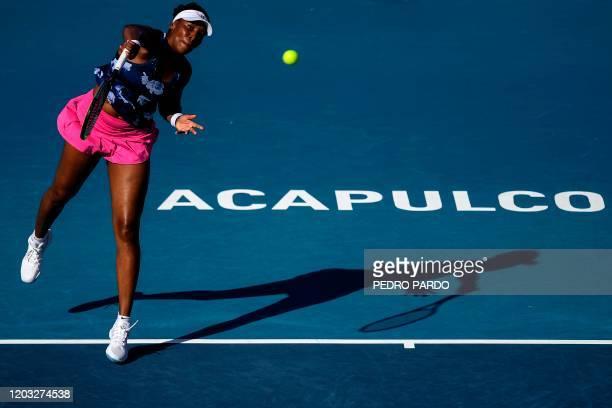 US Venus Williams serves to Slovenia's Kaja Juvan during their Mexico WTA Open women's singles tennis match in Acapulco Guerrero State Mexico on...