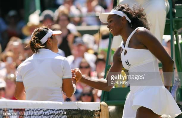 Venus Williams shakes hands with her Thai opponent Tamarine Tanasugarn after winning their quarter-final of the 2008 Wimbledon championships tennis...