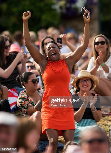 Venus Williams' supporter reacts as she watches the action on the screen from 'Murray Mound' during the Ladies Singles semi final match between...