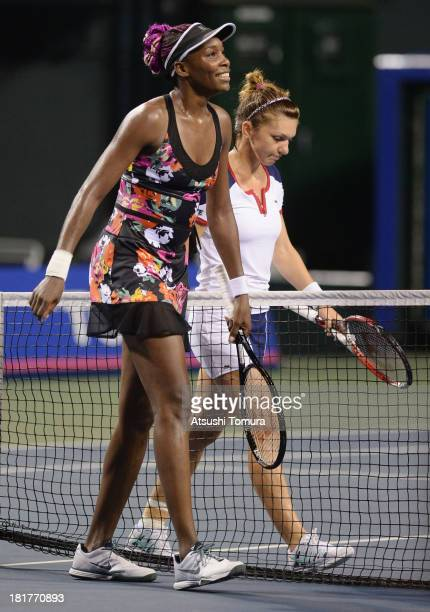 Venus Williams walks with Simona Halep of Romania after their women's singles third round match during day four of the Toray Pan Pacific Open at...