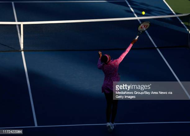 Venus Williams warms-up before her match against Magda Linette for their second round match for the Bank of the West Classic tennis tournament at the...