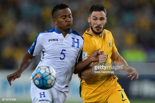 ver Alvarado of Honduras and Mathew Leckie of Australia contest the ball during the 2018 FIFA World Cup Qualifiers Leg 2 match between the Australian...