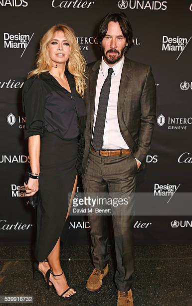 Vera Brezhneva and Keanu Reeves attend the UNAIDS Gala during Art Basel 2016 at Design Miami/ Basel on June 13 2016 in Basel Switzerland