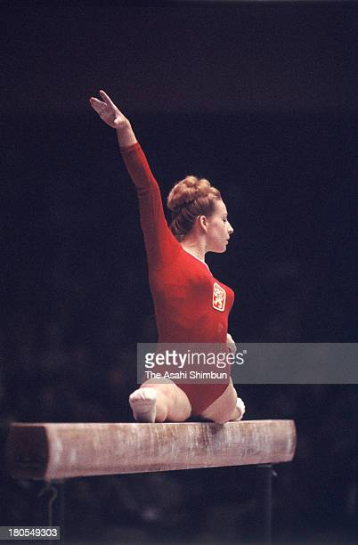 Vera Caslavska of Czechoslovakia competes in the Balance Beam of the Women's Artistic Gymnastics Individual AllAround during the Tokyo Olympics at...