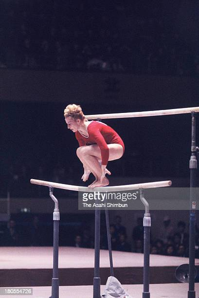 Vera Caslavska of Czechoslovakia competes in the Uneven Bars of the Women's Artistic Gymnastics Individual AllAround during the Tokyo Olympics at...