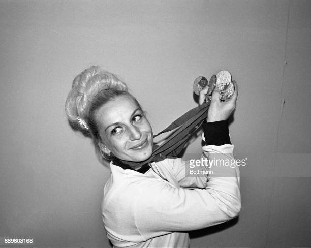 Vera Caslavska of Czechoslovakia displays the four medals she won in Olympic gymnastic competition Vera won three gold and one silver to add to the...
