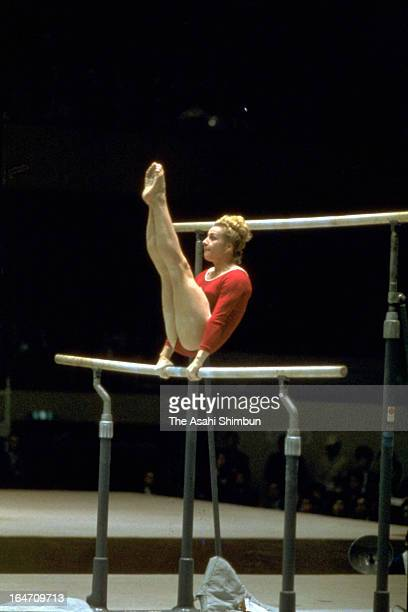 Vera Caslavska of Czechoslovakia performs at Uneven Bars in the Artistic Gymnasitics Women's Individual AllAround during Tokyo Olympic at Tokyo...
