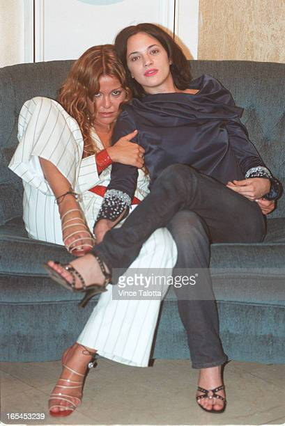 Vera Gemma star of the movie Scarlet Diva shares a couch with star and director Asia Argento during a private photo op at the Four Seasons