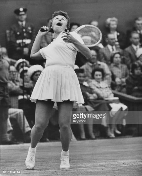 Vera Sukova of Czechoslovakia serves to Maria Bueno of Brazil during their Women's Singles Semi Final match at the Wimbledon Lawn Tennis Championship...